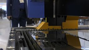 Cut sheet metal. Automation of process. Cutting out parts from metal. Man`s hand takes a detail. Cut sheet metal. Automation of process. Cutting out parts from stock video footage