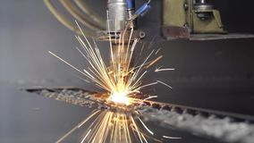 Cut sheet metal at workshop. Modern tool in heavy industry. Dangerous job. High precision manufacture of steel parts. Automation of process indoors. Automatic stock footage