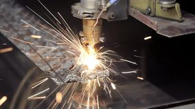 Cut sheet metal at workshop. Modern tool in heavy industry. Dangerous job. High precision manufacture of steel parts. Automation of process indoors. Automatic stock video footage