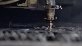 Cut sheet metal at workshop. Modern tool in heavy industry. Dangerous job. High precision manufacture of steel parts. CNC Laser cutting of metal, modern stock video