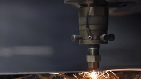 Cut sheet metal at workshop. Modern tool in heavy industry. Dangerous job. High precision manufacture of steel parts. Automation of process indoors. Automatic stock video