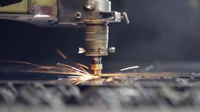 Cut sheet metal at workshop. Modern tool in heavy industry. Dangerous job. High precision manufacture of steel parts. CNC Laser cutting of metal, modern stock footage