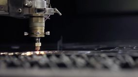 Cut sheet metal at workshop. Modern tool in heavy industry. Dangerous job. High precision manufacture of steel parts. CNC Laser cutting of metal, modern stock video footage