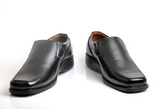 Cut shoes. Black men shoes on background Royalty Free Stock Photos