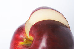 Cut slice of apple. Slice of shiny healthy red apple Royalty Free Stock Image
