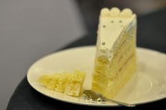 Cut slice of sponge cake on the plate royalty free stock photos