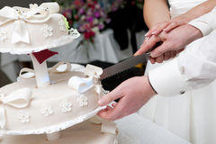 Cut of a slice of a wedding cake Stock Photo