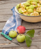 Cut into slices of apples in a bowl for jam Royalty Free Stock Images