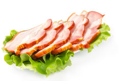 Bacon with lettuce leaves on a white plate Royalty Free Stock Photos