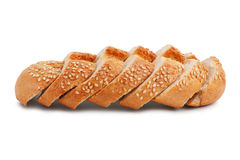 Cut into slices of French bread with sesame seeds. On a white background Royalty Free Stock Image