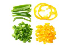 Cut slices of green and yellow sweet bell pepper isolated on white background top view royalty free stock image