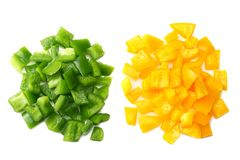 Cut slices of green and yellow sweet bell pepper isolated on white background top view royalty free stock photography