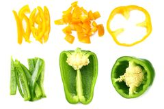 Cut slices of green and yellow sweet bell pepper isolated on white background top view royalty free stock images