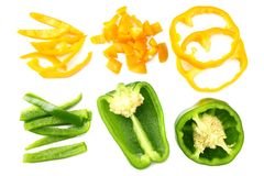 Cut slices of green and yellow sweet bell pepper isolated on white background top view royalty free stock photo