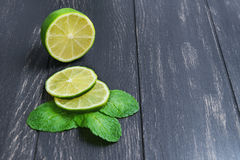 Cut into slices of lime and mint leaves Stock Photo