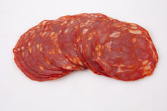 Cut slices of red iberian chorizo Stock Photo
