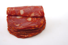 Cut slices of red iberian chorizo Stock Images