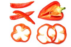 Cut slices of red sweet bell pepper isolated on white background top view royalty free stock images