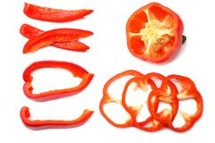 Cut slices of red sweet bell pepper isolated on white background top view stock image