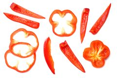 Cut slices of red sweet bell pepper isolated on white background top view stock photos