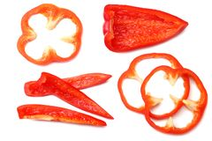 Cut slices of red sweet bell pepper isolated on white background top view stock photo