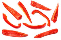 Cut slices of red sweet bell pepper isolated on white background top view royalty free stock image