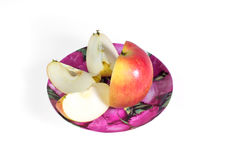 Cut into slices of ripe, juicy apple in a plate on a white background. Vitamin diet for weight loss. Royalty Free Stock Image