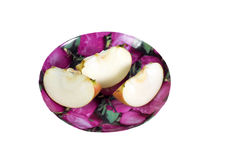 Cut into slices of ripe, juicy apple in a plate on a white background. Vitamin diet for weight loss. Stock Photos