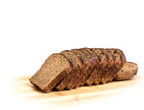 Cut slices of rye bread with caraway seeds on a wooden board ags Royalty Free Stock Photo