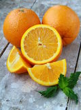 Cut into slices and whole oranges Stock Photos