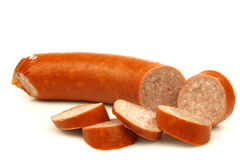 Cut smoked sausage with some pieces. On a white background Stock Images