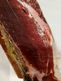 Cut of Spanish ham at the beginning Royalty Free Stock Images