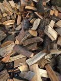 Cut and split pieces of firewood logs from a tree. A pile of split cord wood used to heat homes and fireplaces and wood-burning stove's as an alternative energy Royalty Free Stock Images