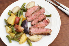 Cut steak with potato and beans salad Royalty Free Stock Images