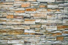 Cut stones. Background texture of assorted cut stones stock photo