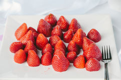 Cut Strawberries on Plate Royalty Free Stock Image