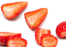 Cut strawberries spread in the space Royalty Free Stock Image