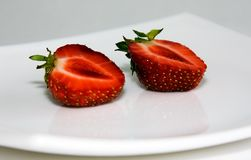 The cut strawberry Stock Photography