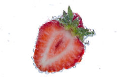 Cut strawberry with bubbles stock image