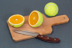 The cut a tennis ball. Or an orange Royalty Free Stock Images