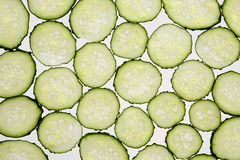 Cut thin slices of cucumber on a transparent white background Stock Photography