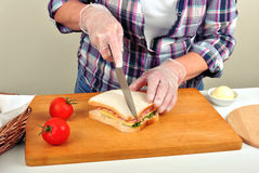 Cut toast bread with a knife Stock Image