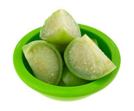 Cut tomatillos in a green dish Royalty Free Stock Photography