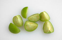 Cut tomatillos on a white cutting board Stock Photography