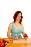 Cut tomato. A young woman wants to cut a tomato Royalty Free Stock Photos