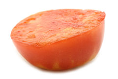 Cut tomato. On the white background Stock Photography