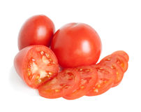 Cut tomato. Cut and whole tomatoes on a white background Stock Photo