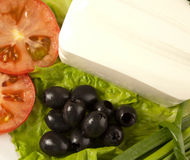 Cut tomato, olives, lettuce and feta cheese Stock Photos