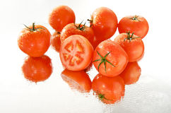 Cut tomato in wet group Royalty Free Stock Images