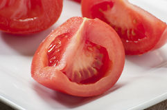 Cut tomato Stock Images